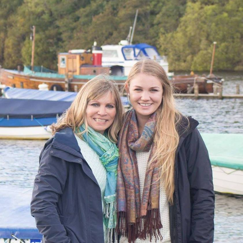 Blonde mother and adult daughter