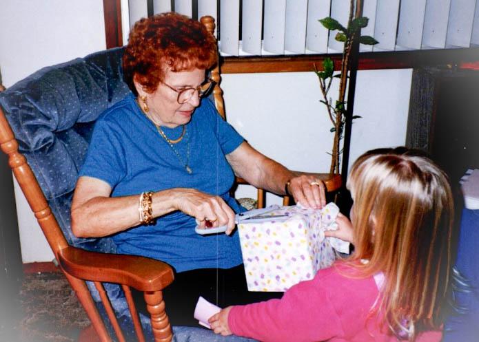 Grandma opening a present